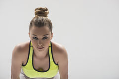 Cheerful female athlete in starting position Stock Photography
