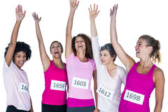 Cheerful female athletes with arms raised stock image