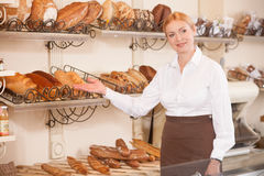 Cheerful female baker is inviting to her shop Stock Photography