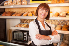 Cheerful female baker is presenting her pastry Royalty Free Stock Photography