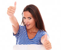 Cheerful female in blue t-shirt with thumbs up Stock Photos
