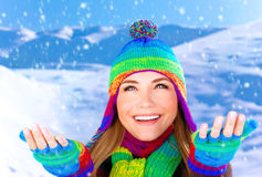 Cheerful female catching snowflakes Stock Photos