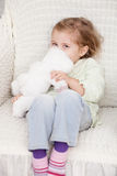 Cheerful female child is playing with fluffy toy Royalty Free Stock Photography