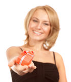 Cheerful female with Christmas gift Stock Image