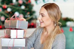 Cheerful female with Christmas gifts stock images