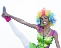 Cheerful Female Clown Gymnastics. Happy Female Clown Holding her Leg up Royalty Free Stock Photography