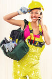 Cheerful female construction worker Stock Photos