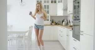 Cheerful female dancing with phone in hand stock video