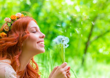 Cheerful female with dandelions royalty free stock photos