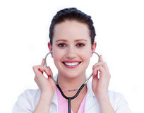 Cheerful female doctor holding a stethoscope Royalty Free Stock Images