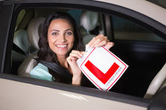 Cheerful female driver tearing up her L sign Royalty Free Stock Photography