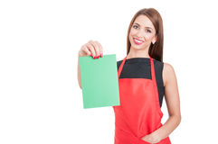 Cheerful female employee holding empty board Royalty Free Stock Photos