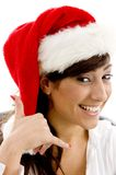 Cheerful female executive in christmas hat with ph Stock Photo