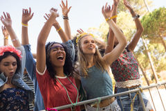 Cheerful female fans enjoying at music festival Royalty Free Stock Photography