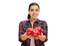 Cheerful female farmer offering apples Royalty Free Stock Images