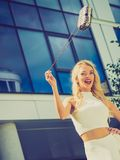 Cheerful fashionable woman in city stock photo