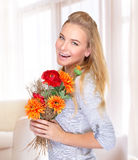 Cheerful female with flowers Stock Image