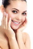 Cheerful female with fresh clear skin. White background stock photography