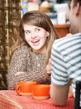 Cheerful Female with Friend in Cafe Stock Photos