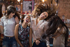 Cheerful female friends dancing Stock Photo