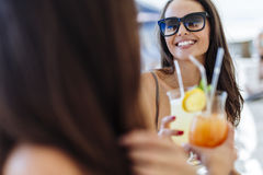 Cheerful female friends drinking cocktails Royalty Free Stock Image