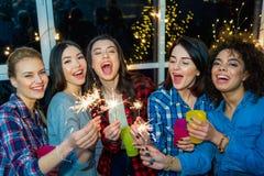Cheerful female friends having fun at celebration stock photos