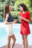 Cheerful female friends holding cocktail. During party Royalty Free Stock Photography