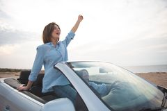 Cheerful female friends are travelling by auto stock photos