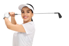 Cheerful female golf player swinging a golf bat Royalty Free Stock Photo