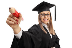 Cheerful female graduate student writing with a large pencil Royalty Free Stock Images