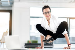 Cheerful female having uncomfortable posture in room Stock Images