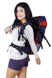 Cheerful female hiker in studio Royalty Free Stock Photos