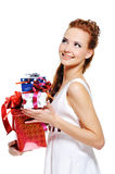 Cheerful female holding the present and looking up Royalty Free Stock Image