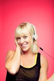 Cheerful Female Listening to Funky Music. Cheerful female having fun while listening to some funky music Royalty Free Stock Photos