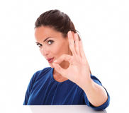 Cheerful female making an ok sign front view Royalty Free Stock Images