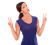 Cheerful female making a victory sign Royalty Free Stock Photos