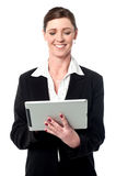 Cheerful female manager using touch pad Stock Photos