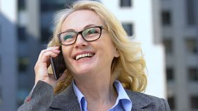 Cheerful female official talking on cell phone, efficient mobile negotiations. Stock footage stock footage