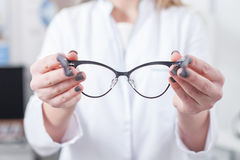 Cheerful female ophthalmologist is working with patient Royalty Free Stock Photos