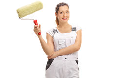Cheerful female painter with a paint roller Royalty Free Stock Images