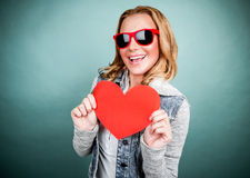 Cheerful female with paper heart Stock Photos