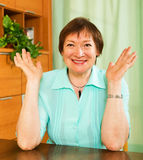 Cheerful female pensioner in green blouse Stock Photo