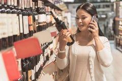 Cheerful female person choosing beverage stock photo