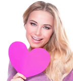 Cheerful female with pink heart. Closeup portrait of cute cheerful female with big paper heart in hands on white background, healthy lifestyle, happy Valentine royalty free stock photos