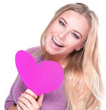 Cheerful female with pink heart. Portrait of cute cheerful female with big paper heart in hands on white background, healthy lifestyle, happy Valentine day royalty free stock photo