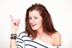 Cheerful female pointing Royalty Free Stock Photo