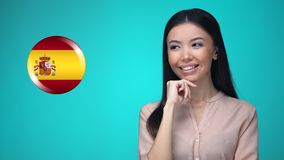 Cheerful female pushing Spanish flag button, ready to learn foreign language. Stock footage stock footage