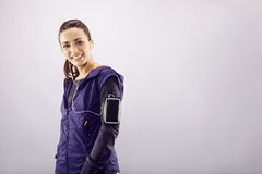 Cheerful female runner on grey background Royalty Free Stock Images