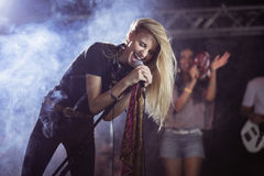 Cheerful female singer performing during music festival Stock Photos