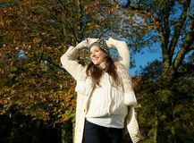 Cheerful female smiling outdoors on a beautiful fall day Stock Image